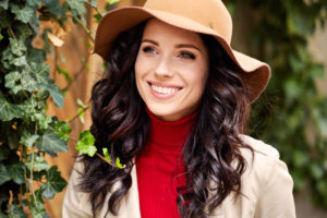 Portrait of fashionably dressed woman in autumn hat. Beauty concept